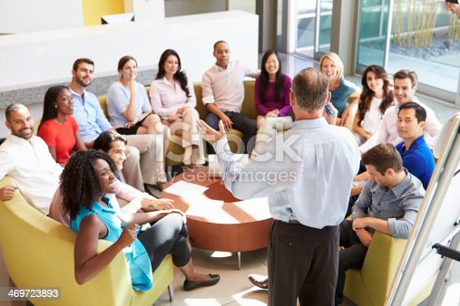 504879112istockphoto Businessman presenting to diverse group of colleagues 469723893