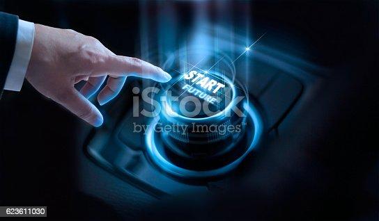 istock Businessman press start future button with virtual light dark background 623611030