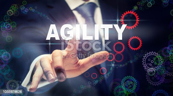 952856170 istock photo A businessman pressing a Agility business concept 1055929626