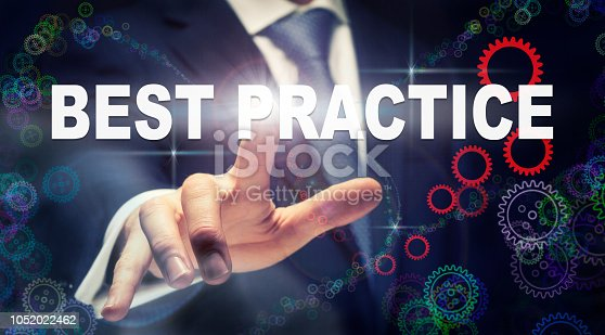 926292396 istock photo A businessman pressing a Best Practice business concept 1052022462