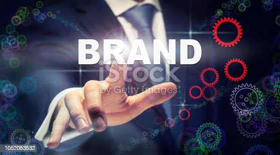 istock A businessman pressing a Brand business concept 1052053532