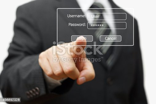 istock businessman pressing authentication button on login display 498892028