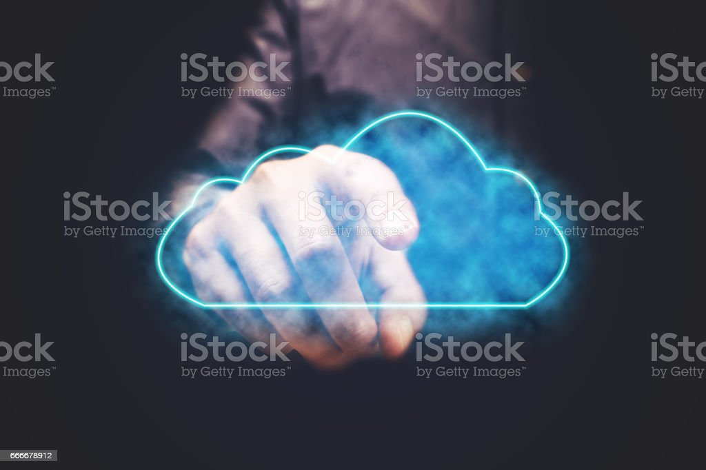 Businessman pressing cloud computing icon with vitual screen. stock photo