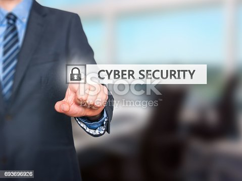 1156072209istockphoto Businessman pressing Cyber Security button on virtual screens 693696926