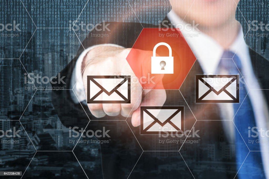 Businessman pressing e-mail security button stock photo