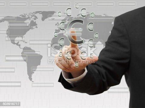 Businessman pressing  euro sign icon