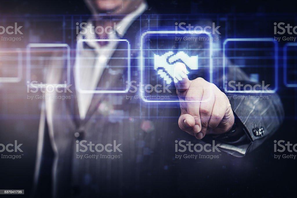Businessman pressing handshake button stock photo
