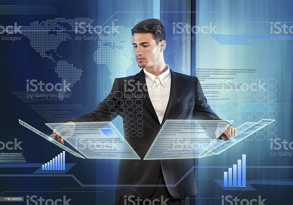 Businessman pressing items on a touch screen panel stock photo