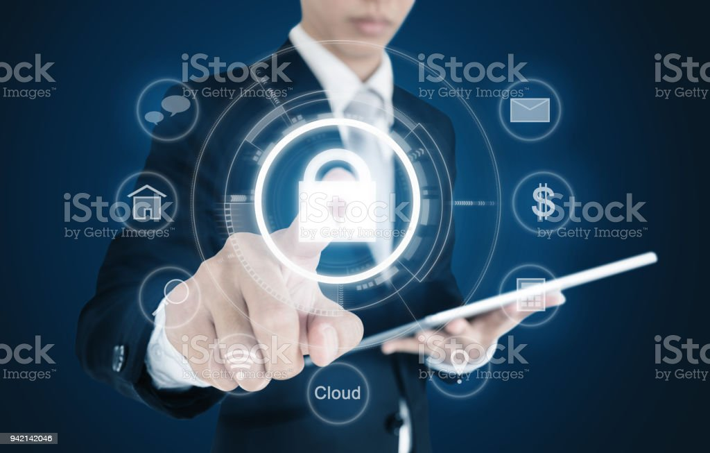 Businessman pressing lock icon on virtual screen. Internet and cyber business security system concept stock photo