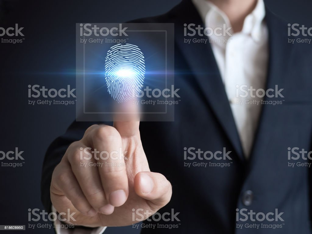 Businessman pressing modern technology panel finger print stock photo