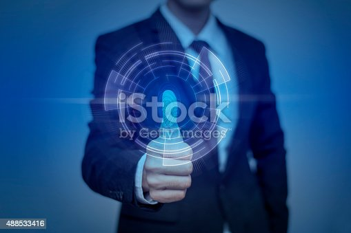 istock Businessman pressing modern technology panel with finger print r 488533416