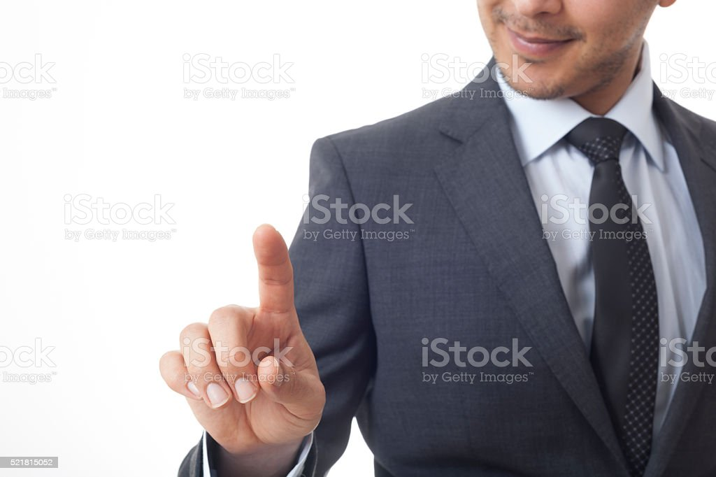 Businessman pressing on the empty digital touch screen stock photo