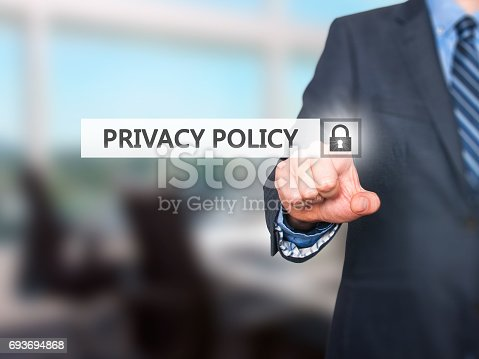 istock Businessman pressing Privacy Policy button on virtual screens 693694868