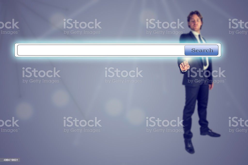 Businessman pressing Search engine button stock photo