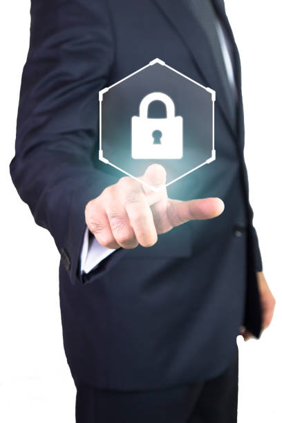 businessman pressing security button on virtual screens stock photo