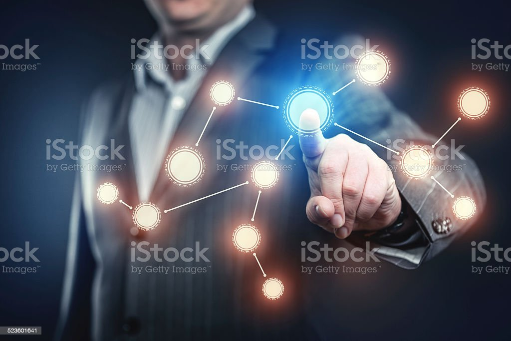 Businessman pressing social network button stock photo