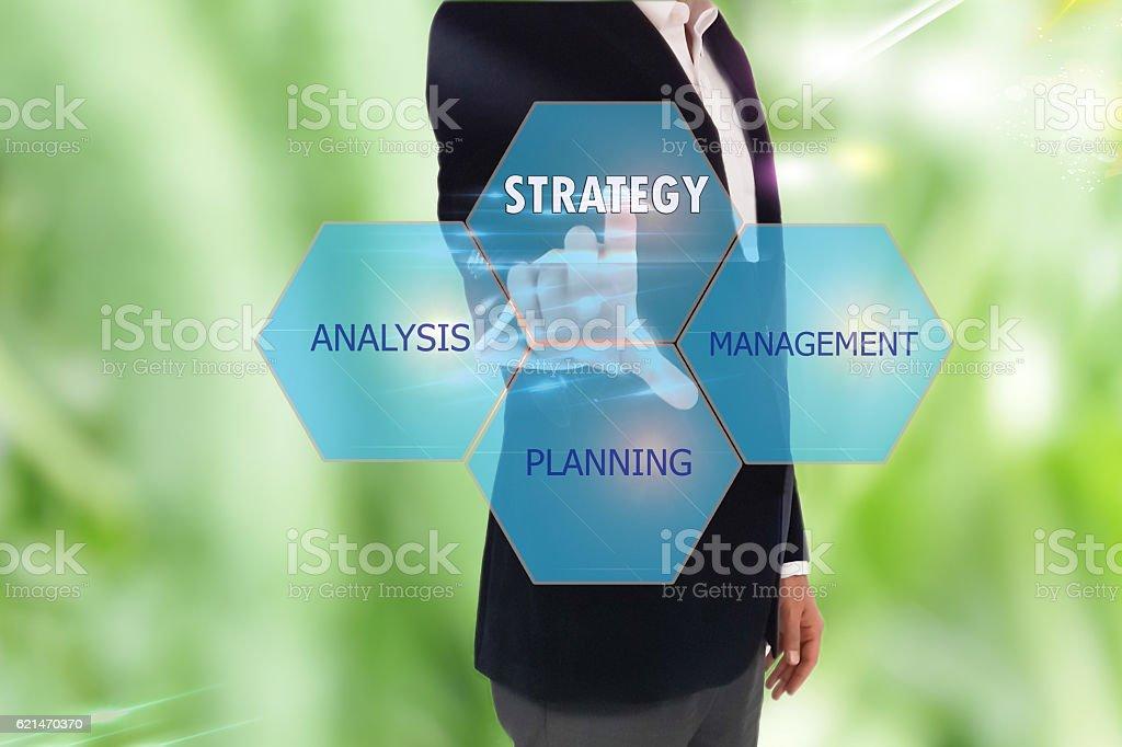 businessman pressing strategy button on virtual screens stock photo