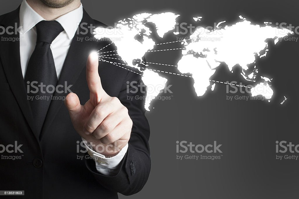 businessman pressing touchscreen worldmap stock photo