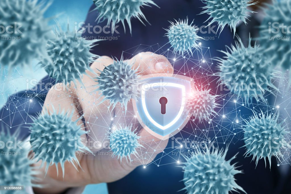 Businessman produces protection against viruses on the network. stock photo