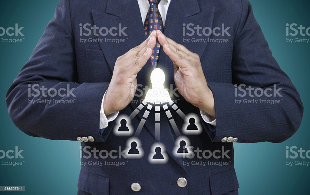Businessman Protecting Client's stock photo