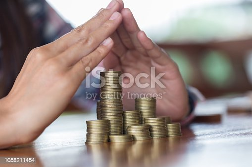 929887844 istock photo Businessman Protecting Coins. Financial safety Concept. 1058211454
