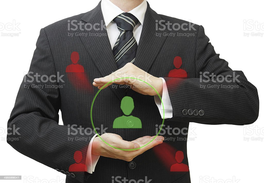 businessman protecting customer or human resources from competition stock photo
