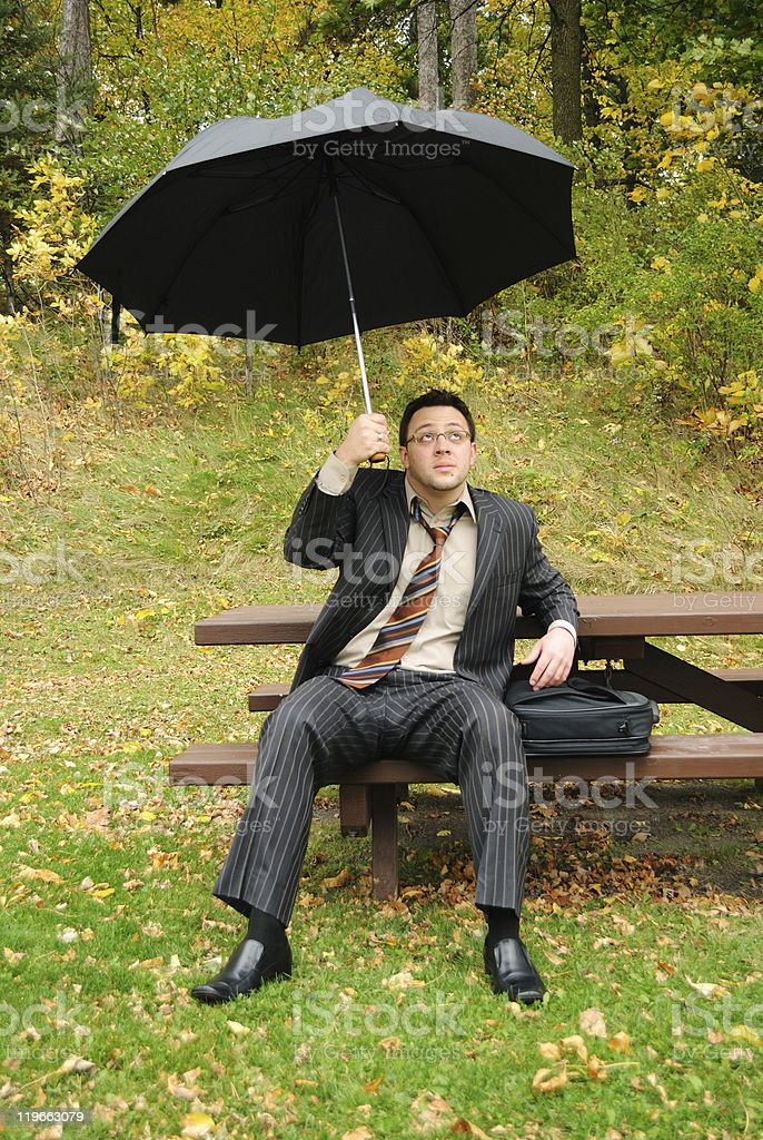 Businessman protecting from troubles royalty-free stock photo