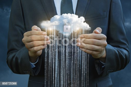 istock Businessman protects the flow of information from the cloud. 858725366