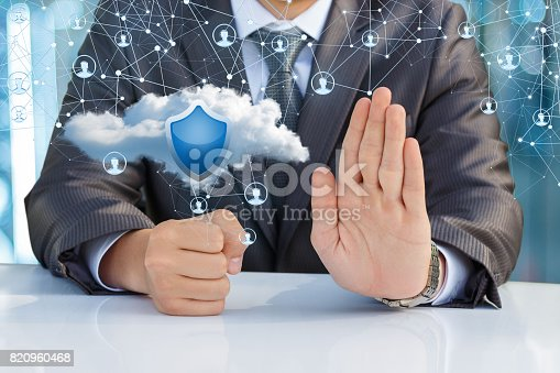 istock Businessman protects the network sitting in the office. 820960468