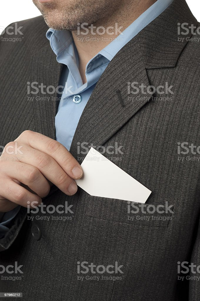 Businessman pull business card from the pocket of a suit royalty-free stock photo