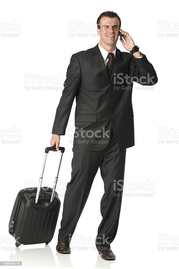 Businessman pulling a suitcase royalty-free stock photo