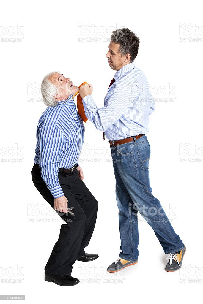businessman pulling a tie to older man royalty-free stock photo