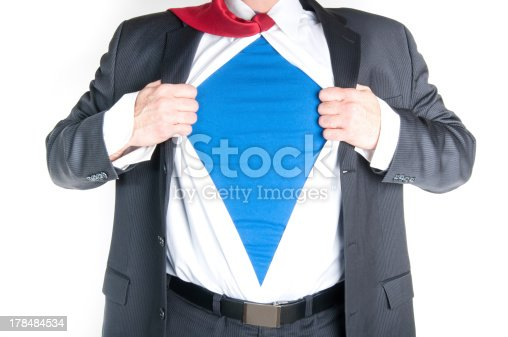 158909167istockphoto Businessman pulling apart shirt to reveal he is a superhero 178484534
