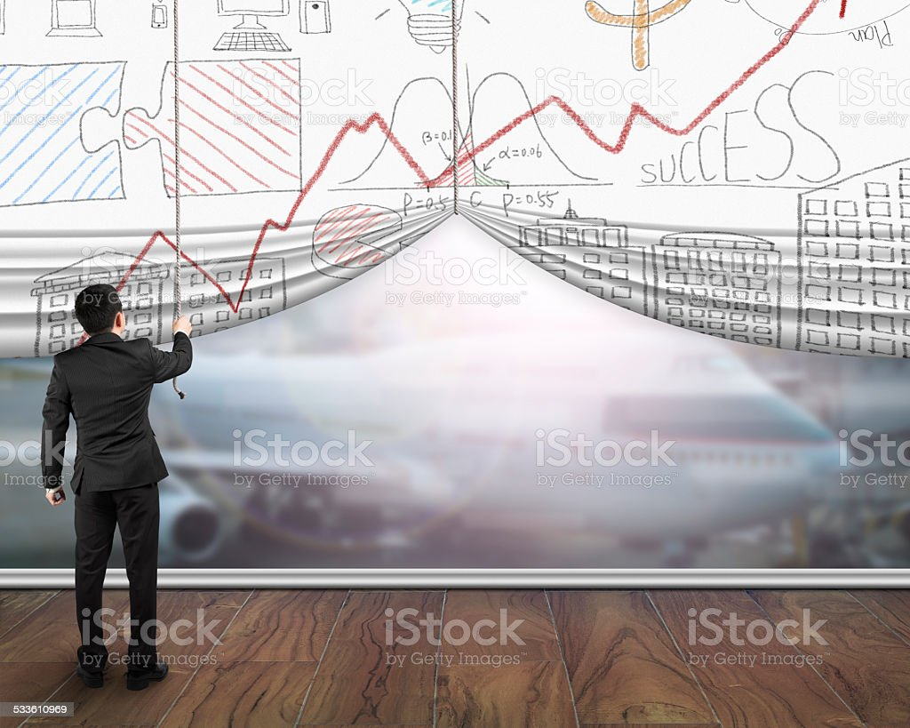Businessman pulling open business doodles curtain showing airp stock photo