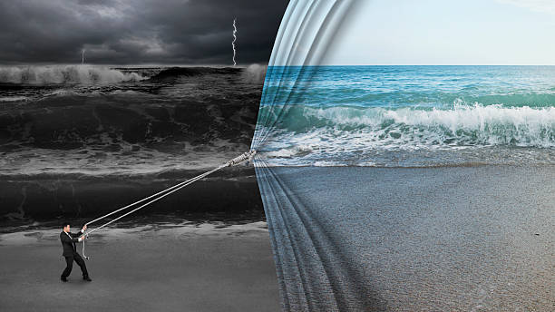 businessman pulling open calm sea curtain covered dark stormy oc stock photo