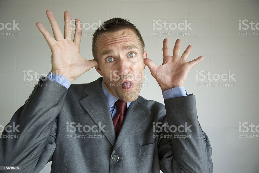 Businessman Pulls a Mocking Face royalty-free stock photo