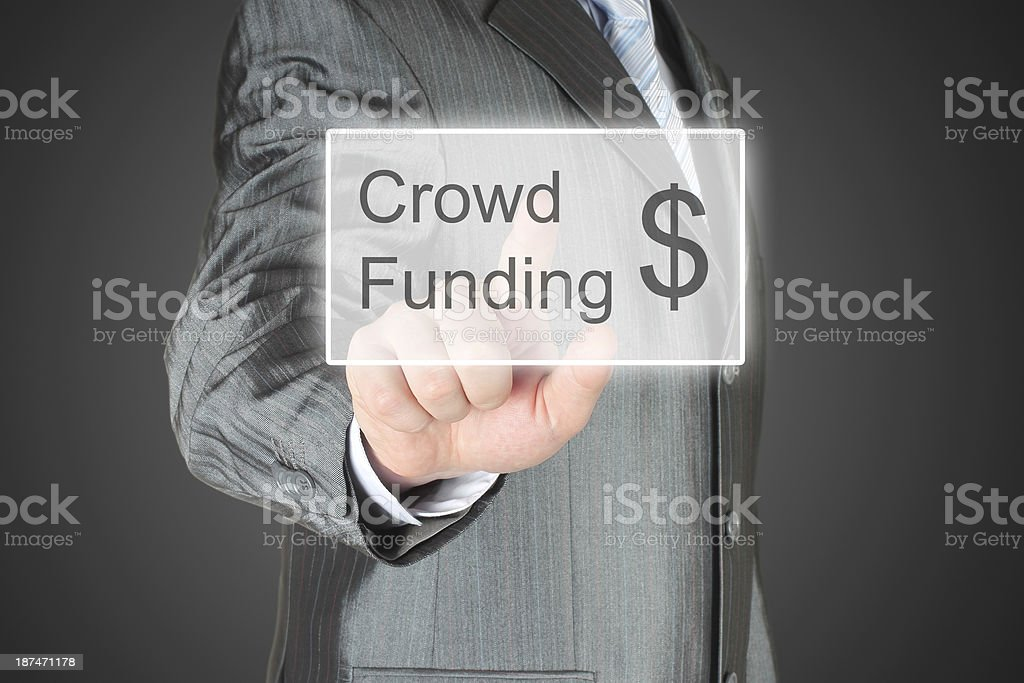 Businessman pushes virtual crowd funding button royalty-free stock photo