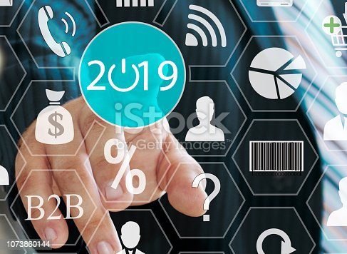1063751940 istock photo Businessman pushing 2019 on virtual screens . Business innovation, business vision ,  webinar, launch in 2019 . 1073860144
