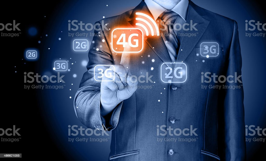 Businessman pushing 4g stock photo