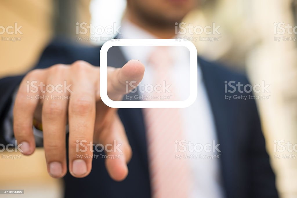 Businessman pushing a Button royalty-free stock photo