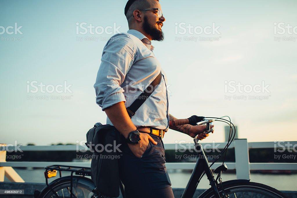 Businessman Pushing Bicycle. stock photo