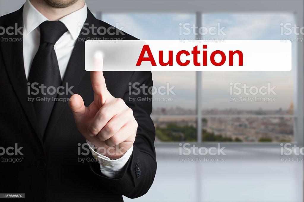 businessman pushing button auction stock photo