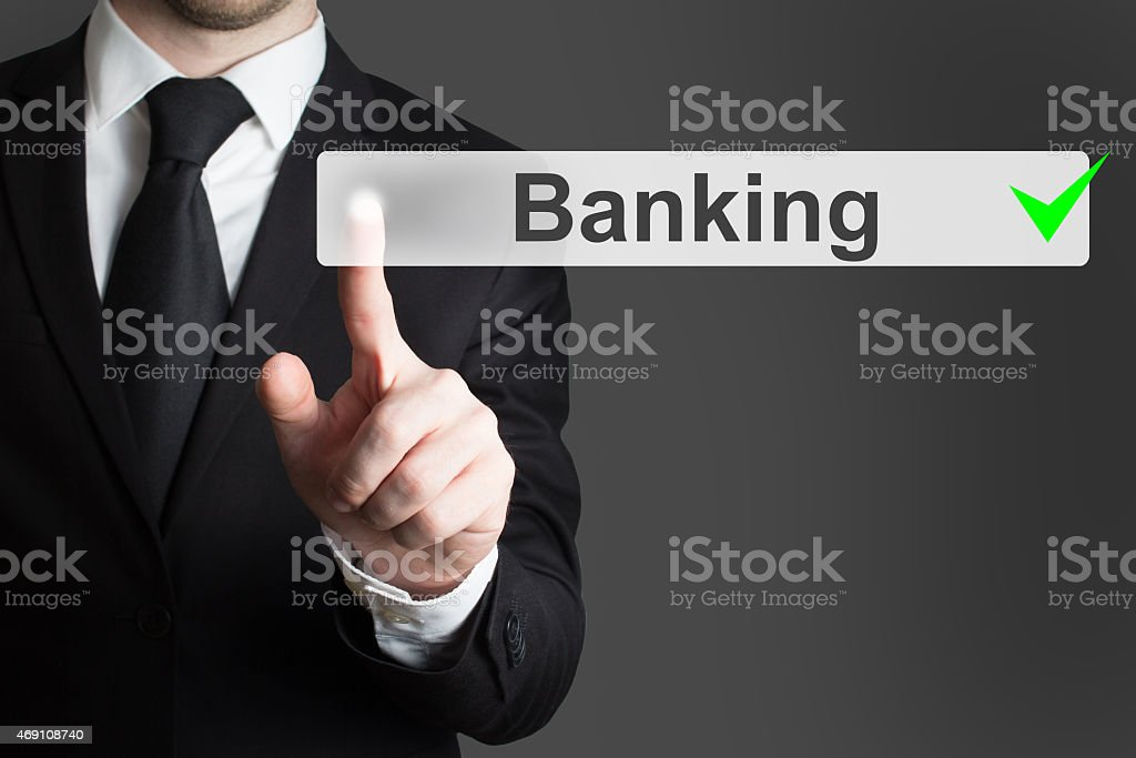 businessman pushing button banking stock photo