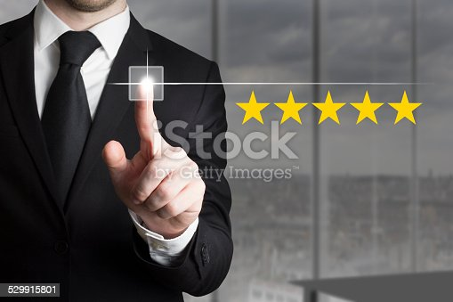 istock businessman pushing button five star rating 529915801