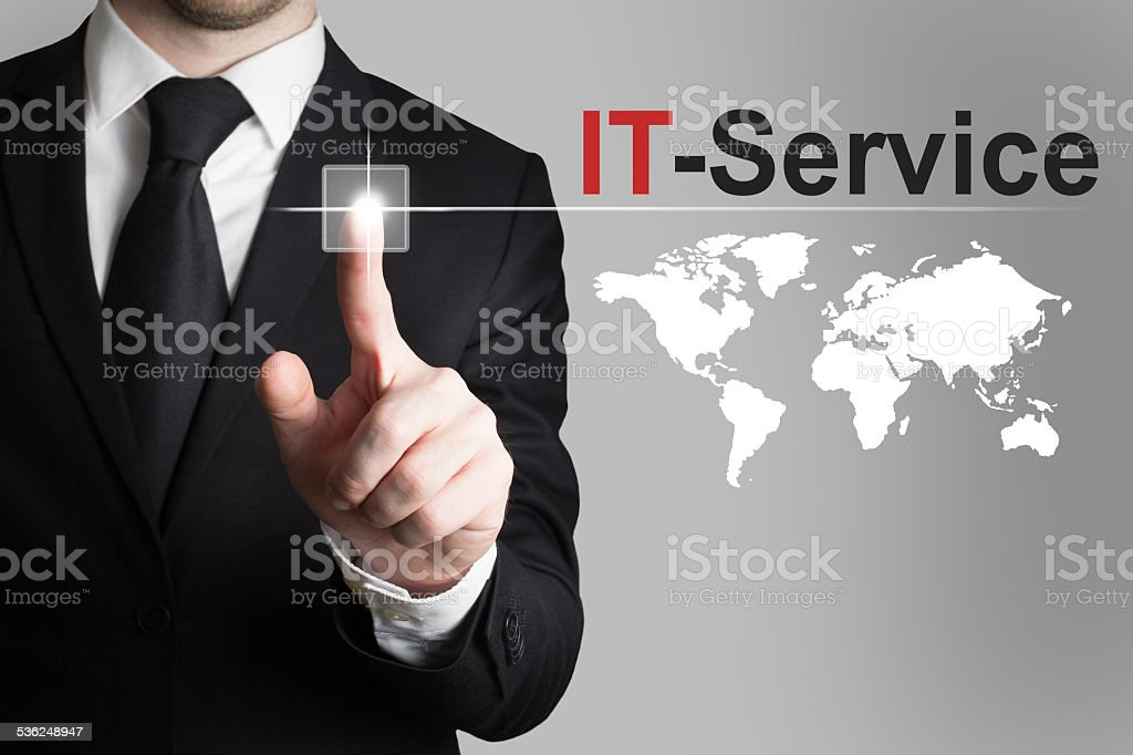 businessman pushing button it service global stock photo