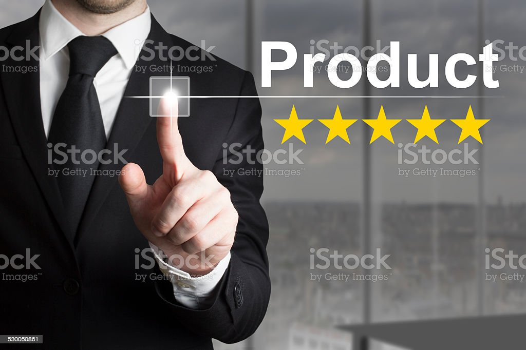 businessman pushing button product rating stars stock photo