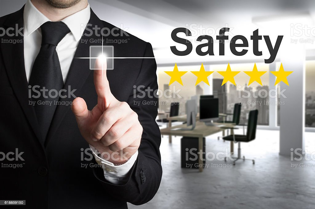 businessman pushing button safety five star rating stock photo