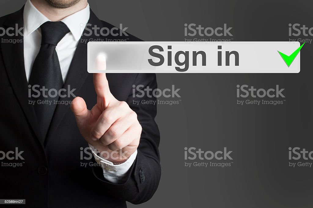 businessman pushing button sign in stock photo