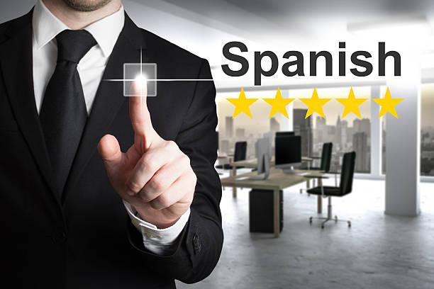 businessman pushing button spanish - spanisch translator stock-fotos und bilder