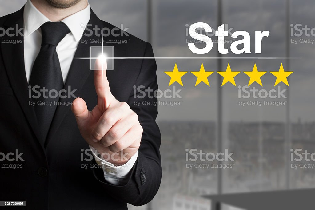 businessman pushing button star celebrity stock photo